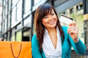 Woman holding new credit card